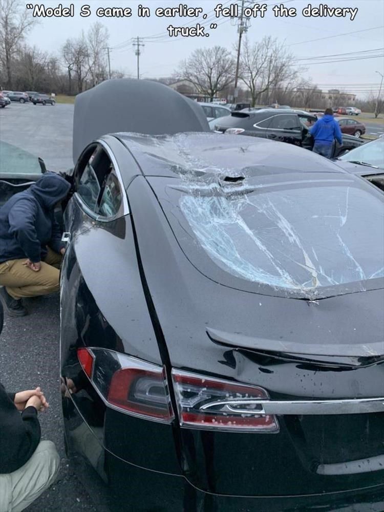"""Land vehicle - """"Model S came in earlier, fell off the delivery truck."""""""