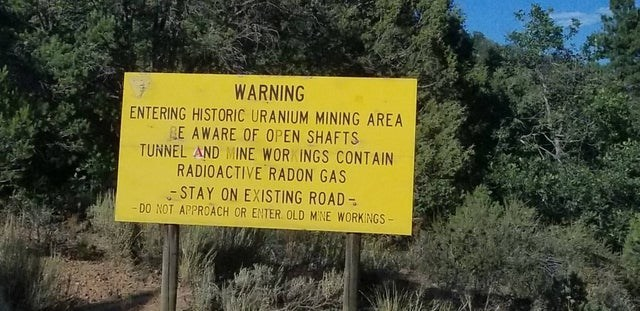 Nature - WARNING ENTERING HISTORIC URANIUM MINING AREA LE AWARE OF OPEN SHAFTS TUNNEL AND MINE WOR INGS CONTAIN RADIOACTIVE RADON GAS - STAY ON EXISTING ROAD- DO NOT APPROACH OR ENTER. OLD MINE WORKINGS-
