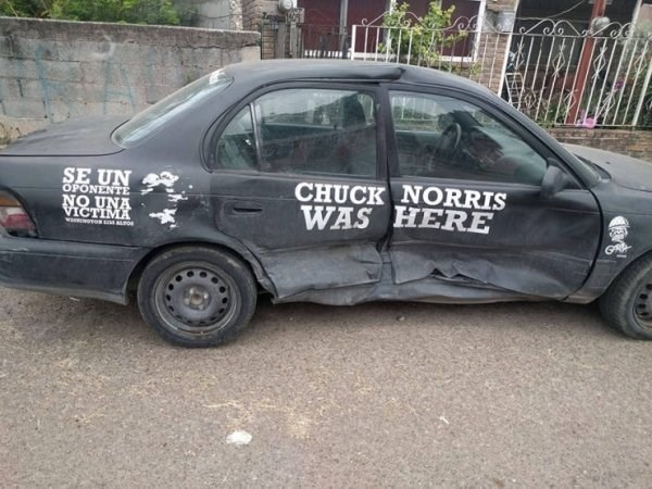 funny meme picture showing a car that was busted up and a signed with chuck norris name