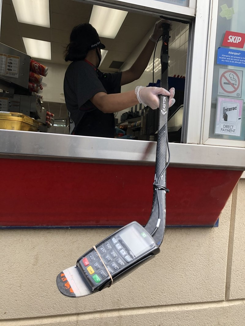 cool picture showing a creative way to pay during covid19 by attaching the credit card payment to a stick