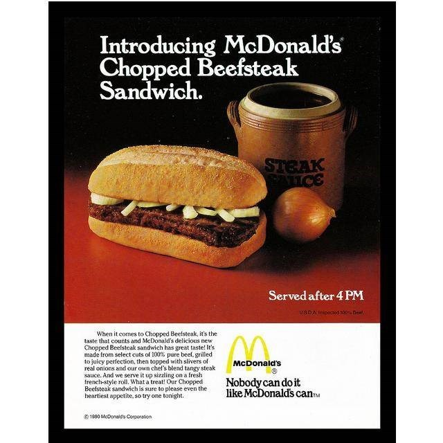 Food - Introducing McDonald's Chopped Beefsteak Sandwich. STEAK SATICE Served after 4 PM UBDA icociod a00 Dent When it comes to Chopped Beefsteak, it's the taste that counts and MeDonald's delicious new Chopped Beelsteak sandwich has great taste! It's made from select cuts of 100% pure beef, grilled to juicy perfection, then topped with slivers of real onions and our own chel's blend tangy steak sauce. And we serve it up sizzling on a fresh french-style roll. What a treat! Our Chopped Beefsteak