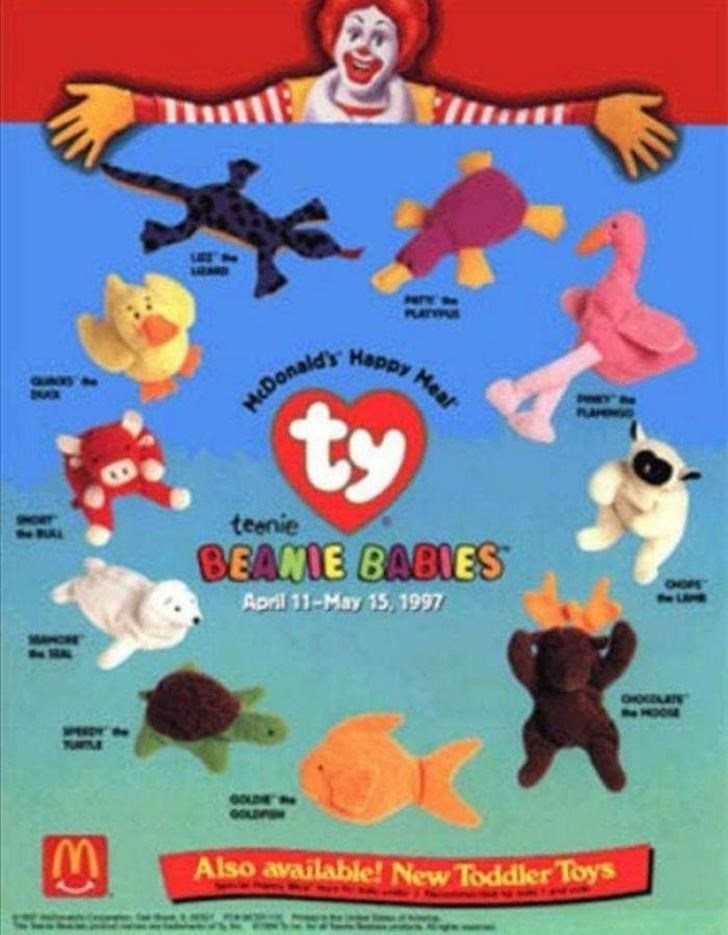 Cartoon - wwen PAPY oe PLUNAS Happy Mear MEDonald's ty PAMINIO teenie BEANIE BABIES GOE April 11-May 15, 1997 HOO TUILE Also available! New Toddler Toys