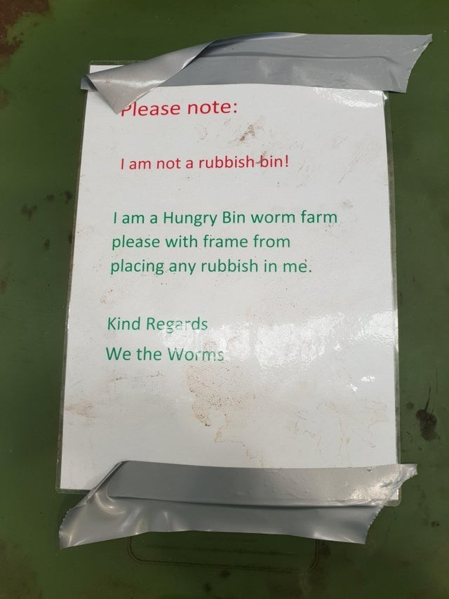 Text - Please note: I am not a rubbish-bin! I am a Hungry Bin worm farm please with frame from placing any rubbish in me. Kind Regards We the Worms