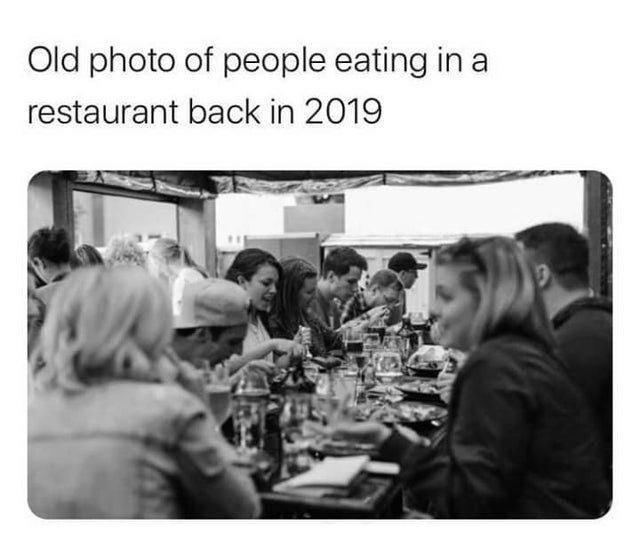 Photograph - Old photo of people eating in a restaurant back in 2019