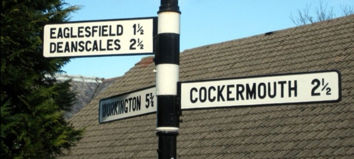 Street sign - EAGLESFIELD 1% DEANSCALES 2% ORKWECTON 5% COCKERMOUTH 2½