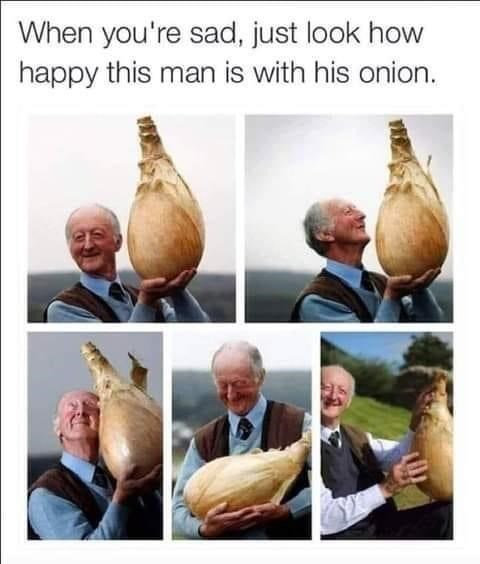 Onion - When you're sad, just look how happy this man is with his onion.