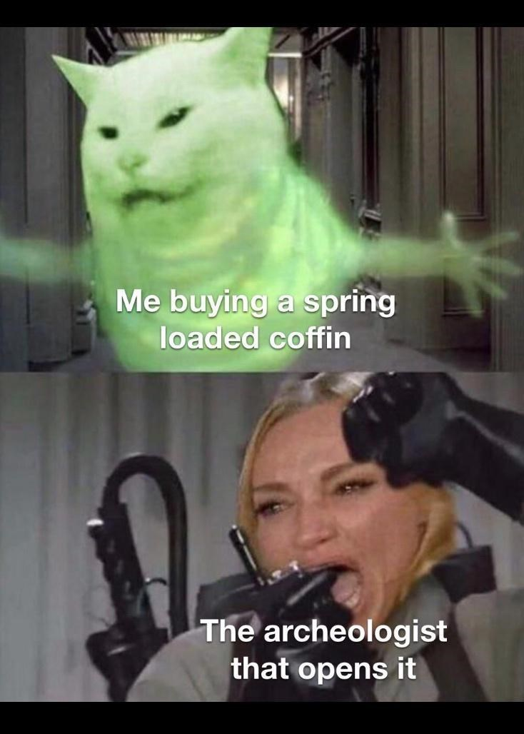 Photo caption - Me buying a spring loaded coffin The archeologist that opens it