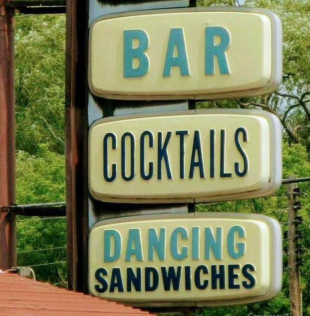 Street sign - BAR COCKTAILS DANCING SANDWICHES