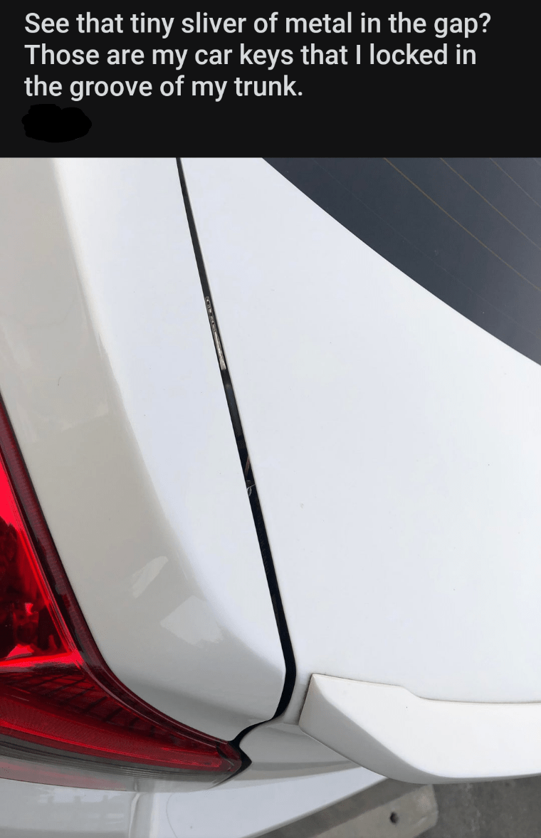 Automotive exterior - See that tiny sliver of metal in the gap? Those are my car keys that I locked in the groove of my trunk.