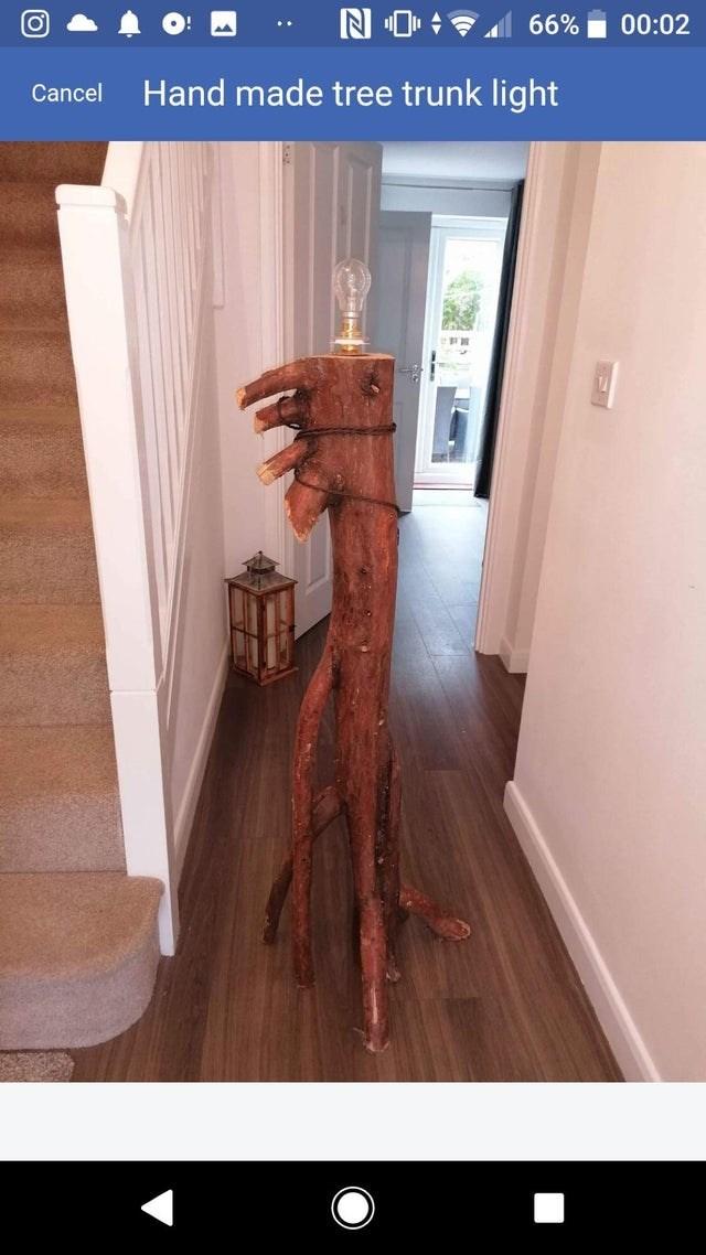 Wood - N O 66% 00:02 .. Cancel Hand made tree trunk light