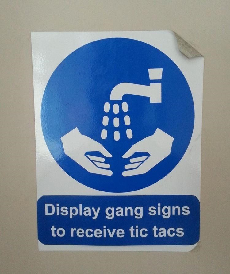 Sign - Display gang signs to receive tic tacs