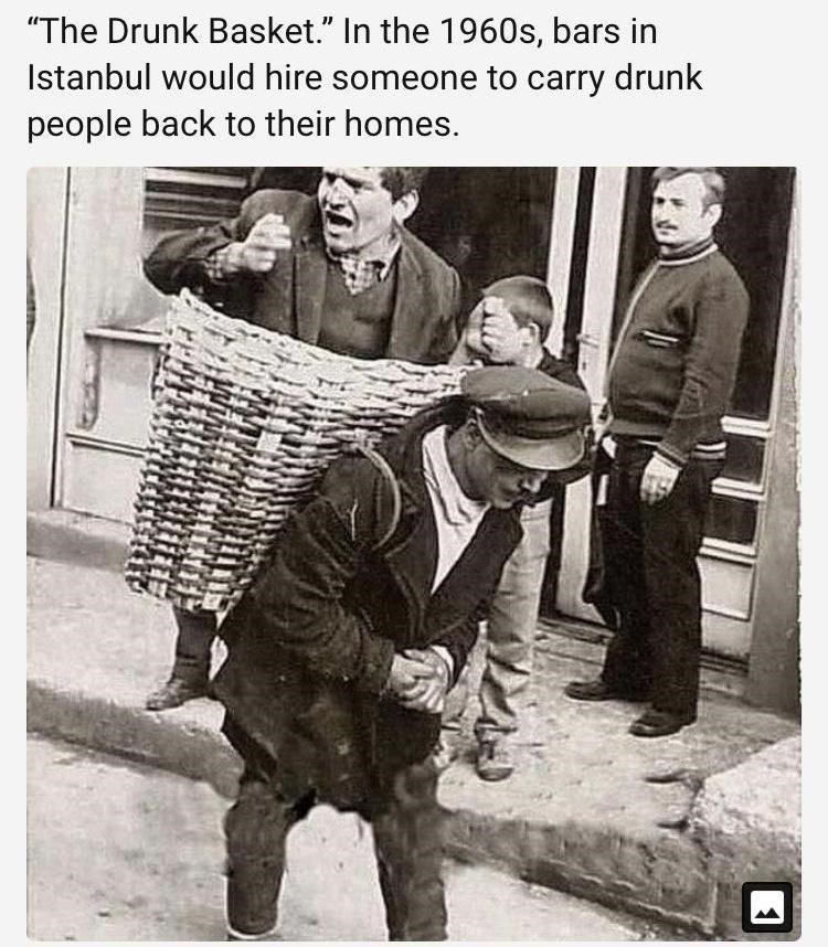 """Photo caption - """"The Drunk Basket."""" In the 1960s, bars in Istanbul would hire someone to carry drunk people back to their homes."""