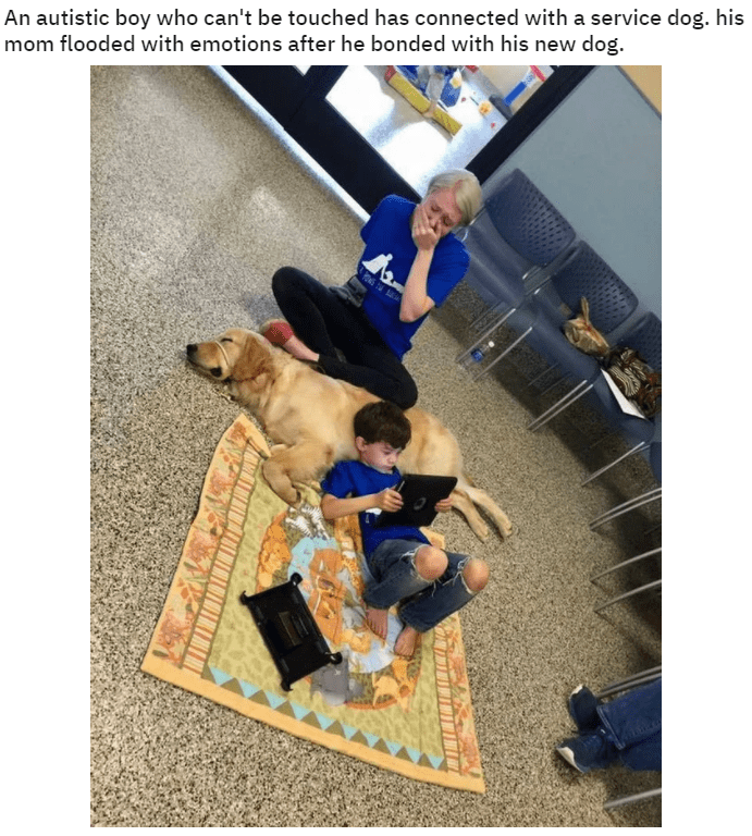 An autistic boy who can't be touched has connected with a service dog. his mom flooded with emotions after he bonded with his new dog. child lying on the floor with his head resting on the body of a dog and an emotional woman sitting beside them