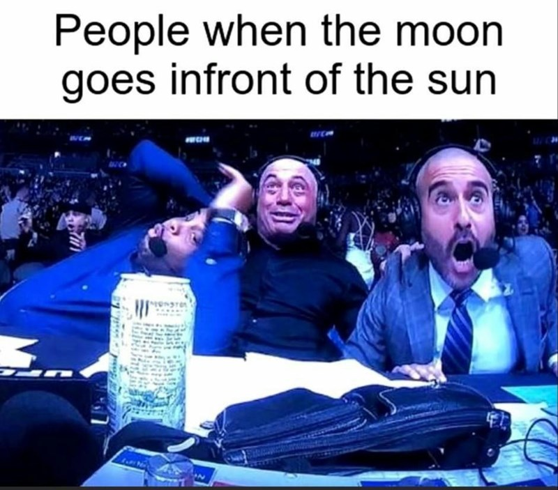 Photo caption - People when the moon goes infront of the sun