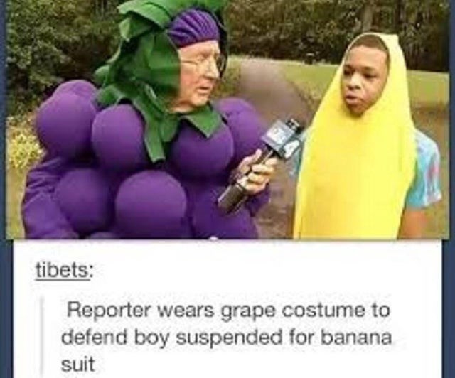 Purple - tibets: Reporter wears grape costume to defend boy suspended for banana suit