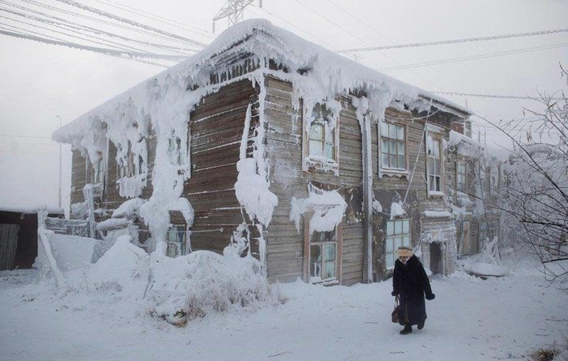 photo frozen house in oymyakon icicles