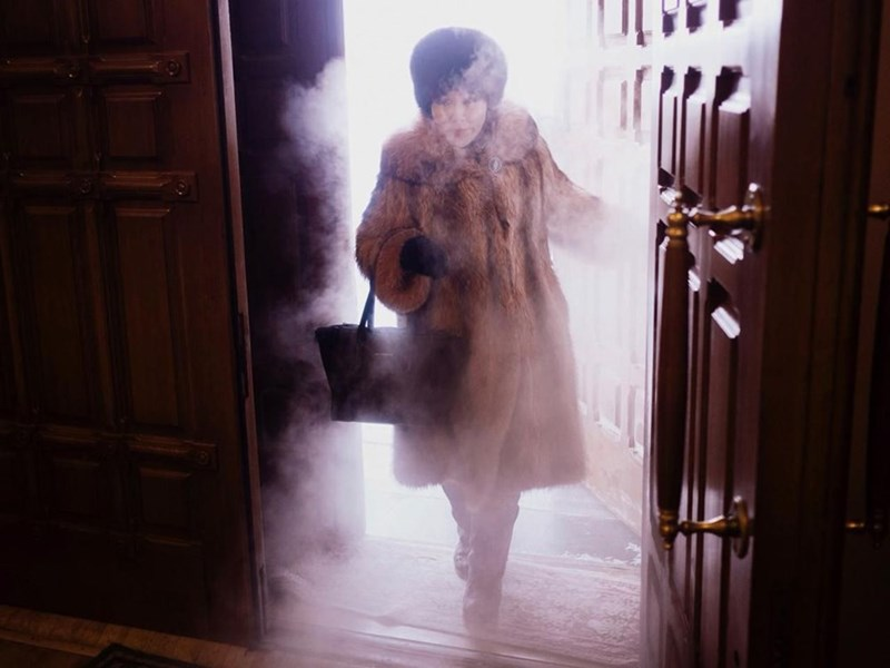 gif woman entering house from outside snow freezing steam coming inside