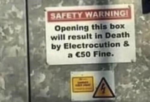 Text - SAFETY WARNING! Opening this box will result in Death by Electrocution & a C50 Fine.