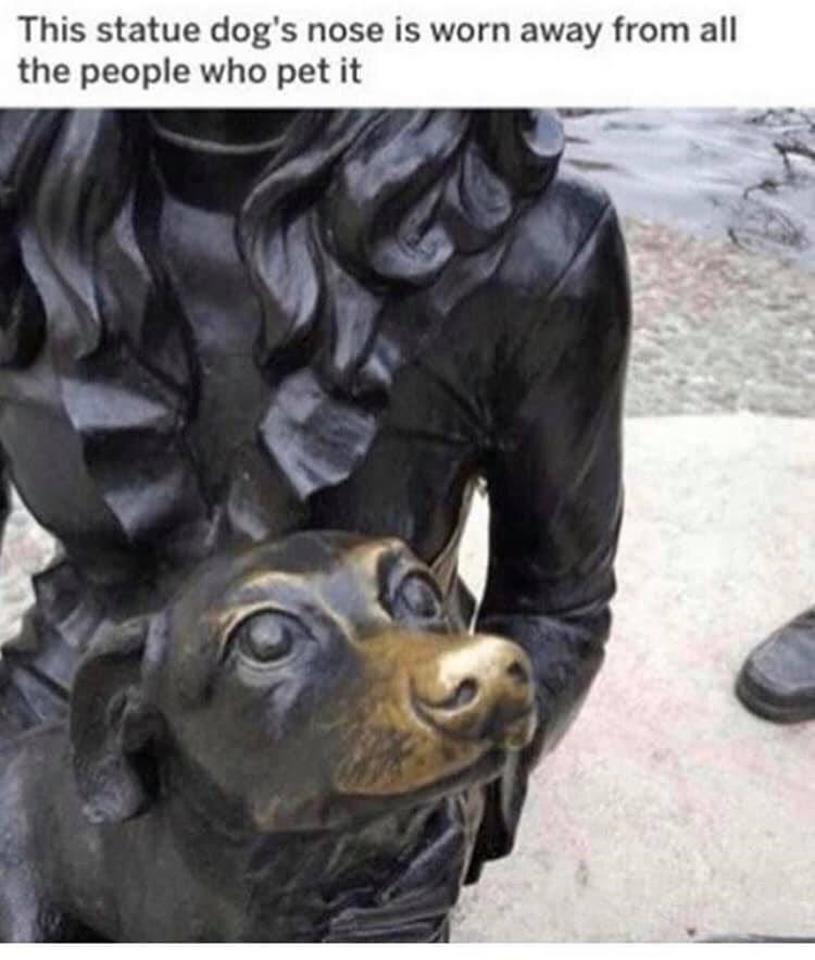 Dog breed - This statue dog's nose is worn away from all the people who pet it