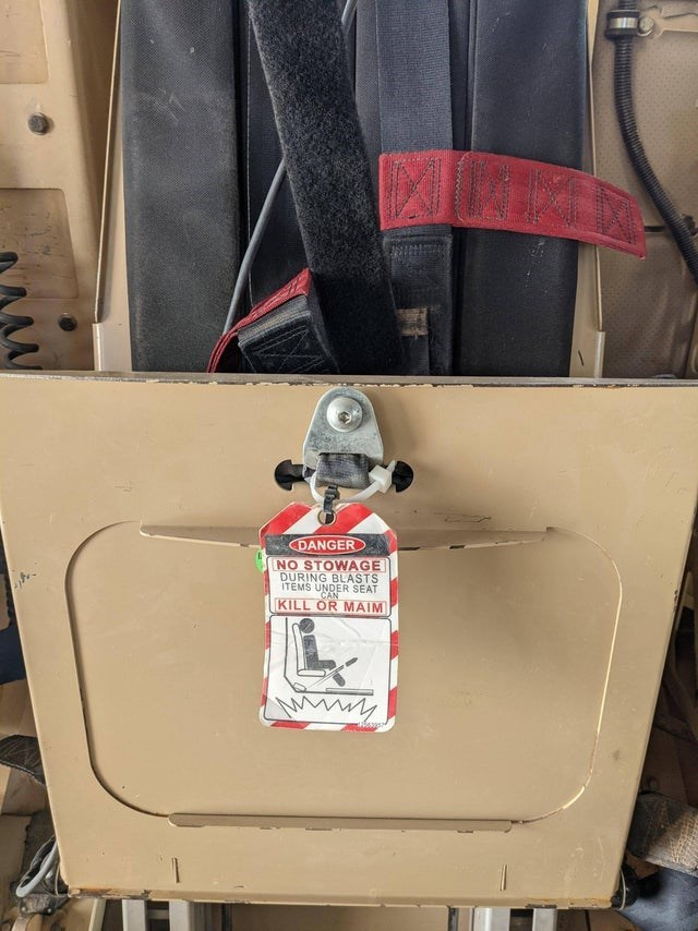 White - DANGER NO STOWAGE DURING BLASTS ITEMS UNDER SEAT CAN KILL OR MAIM
