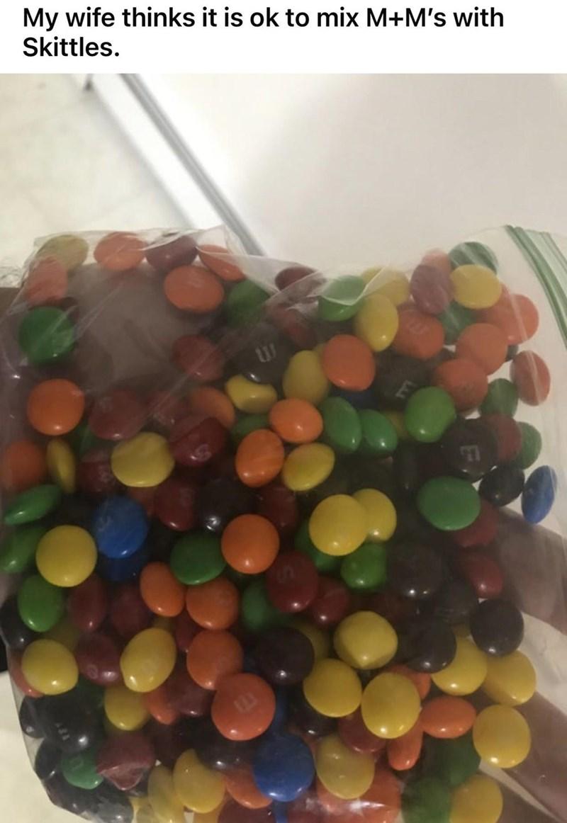 Food - My wife thinks it is ok to mix M+M's with Skittles.