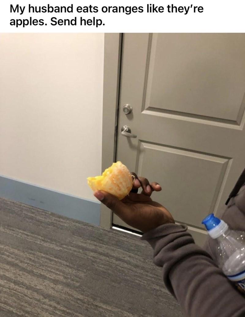 Wood - My husband eats oranges like they're apples. Send help.