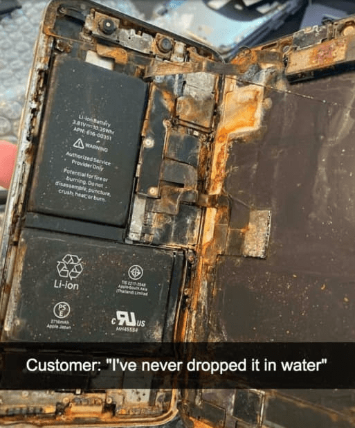 """Font - L-lon Bamiry 3.81y10.3sw APNE 616-00 AWARNING Authorized Service Provider Only Potential tor firer burning Donet . disassemple, puncture crush, heatorburn (Thalen ad Li-ion us MHASS4 AppleJan Customer: """"I've never dropped it in water"""""""