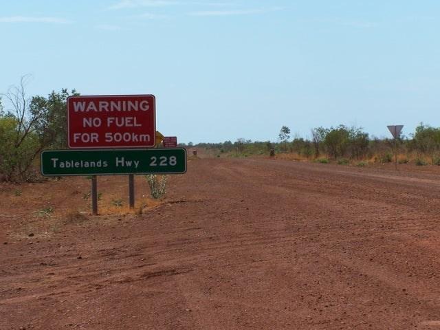 https://i.chzbgr.com/full/9606122240/h30B1A99C/traffic-sign-warning-no-fuel-500km-tablelands-hwy-228