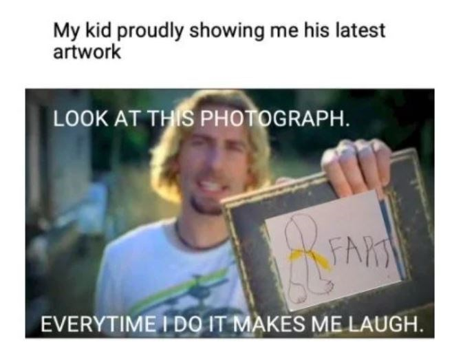 Smile - My kid proudly showing me his latest artwork LOOK AT THIS PHOTOGRAPH. FARS EVERYTIME I DO IT MAKES ME LAUGH.