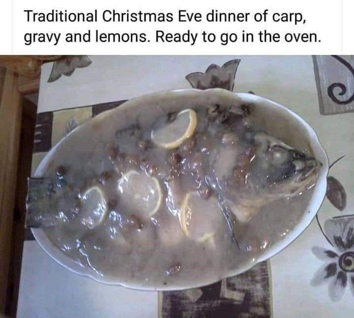 Food - Traditional Christmas Eve dinner of carp, gravy and lemons. Ready to go in the oven.