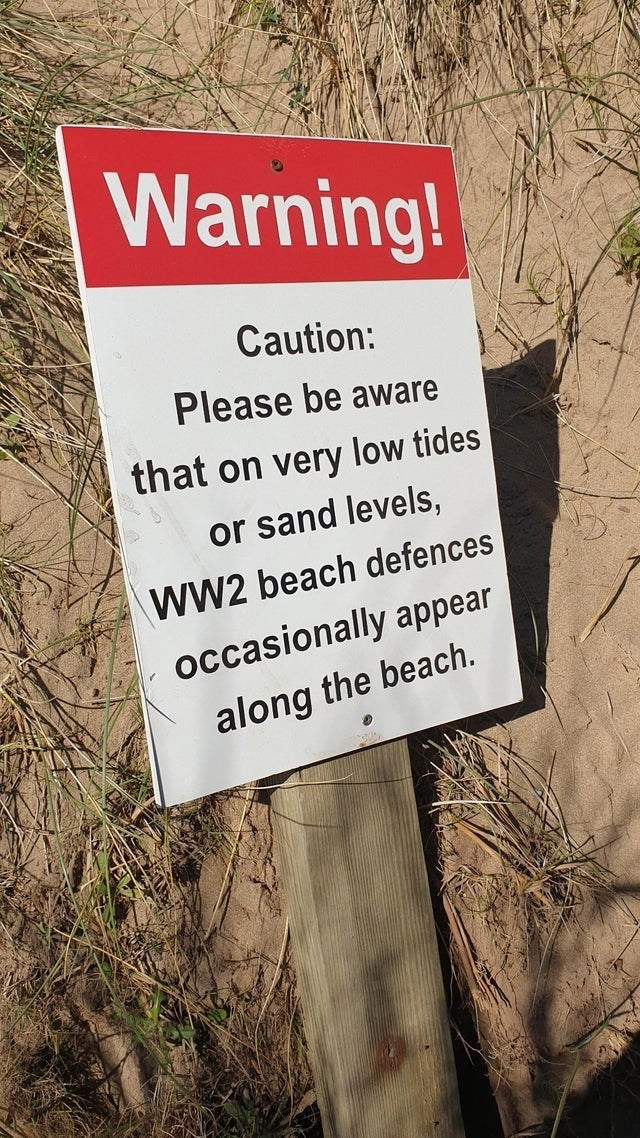 scary warning signs - Plant - Warning! Caution: Please be aware that on very low tides or sand levels, WW2 beach defences occasionally appear along the beach.