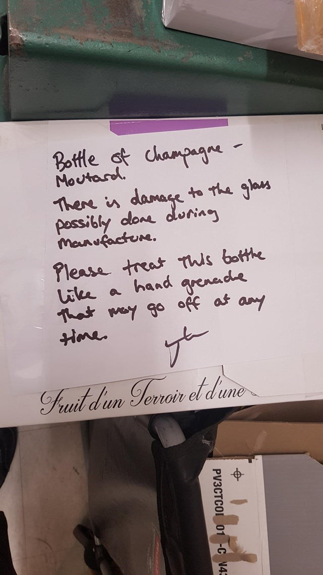 scary warning signs - Handwriting - Bottle ot champagne Moutard. There is damage to the glass pessibly done during Manufacture. Please treat This botthe Like a hand grenade That may go off at any Home. Fuit dun Toroir el diun PV3CTCOI 01 -C N43