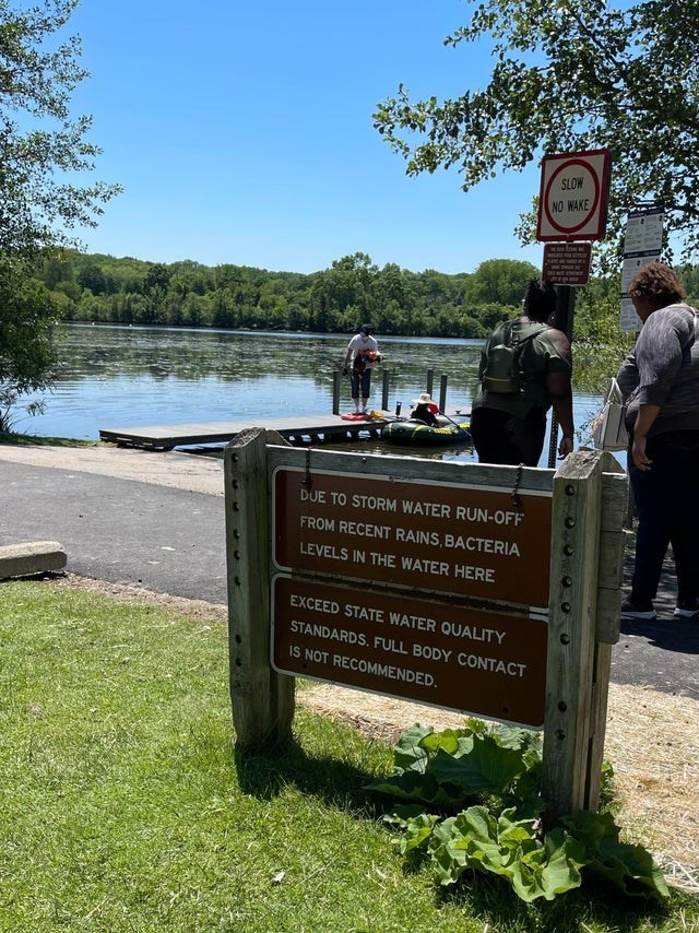 scary warning signs - Water - SLOW NO WAKE DUE TO STORM WATER RUN-OFF FROM RECENT RAINS, BACTERIA LEVELS IN THE WATER HERE EXCEED STATE WATER QUALITY STANDARDS. FULL BODY CONTACT IS NOT RECOMMENDED.