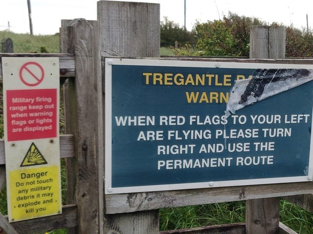 scary warning signs - Property - Military firing range keep out when warning flags or lights are displayed TREGANTLER WARN WHEN RED FLAGS TO YOUR LEFT ARE FLYING PLEASE TURN RIGHT AND USE THE PERMANENT ROUTE Danger Do not touch any military debris it may explode and. kill you