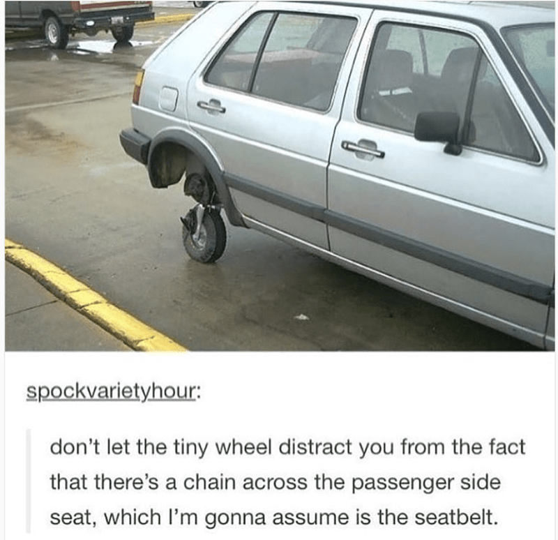 Tire - spockvarietyhour: don't let the tiny wheel distract you from the fact that there's a chain across the passenger side seat, which I'm gonna assume is the seatbelt.