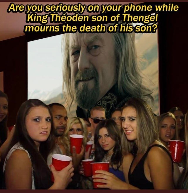 Hairstyle - Are you seriously on your phone while King Théoden son of Thengel mourns the death of his son?