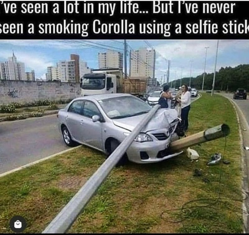 Car - ve seen a lot in my life... But I've never seen a smoking Corolla using a selfie stick