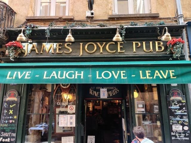 Window - JAMES JOYCE PUB LIVE- LAUGH LOVE - LEAVE LD IRISH WHISKIES WINE PIRIS GUINNESS Teh+ PLEASE RESPECT DE NEIGHBOURS AND SHUT THE Shal Feek uP