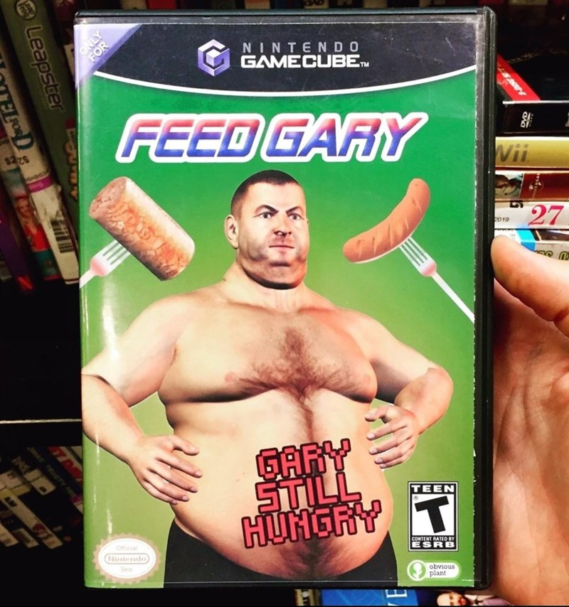 Hand - ONLY NINTENDO GAMECUBEn FEED GARY $225 Wii POADGE 27 019 GARY STILL HUNGRY T TEEN Ofticial Nintendo CONTENT RATED BY ESRB Seal obvious plant Leapster FOR