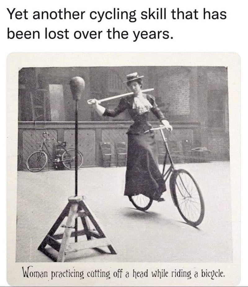 Bicycle - Yet another cycling skill that has been lost over the years. Woman practicing catting off a head while riding a bicycle.