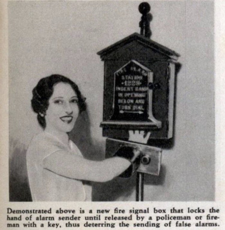 Photograph - STAIN 1228 INSERT BAN IN PPEMING BELON AND TURS DIAL Demonstrated above is a new fire signal box that locks the hand of alarm sender until released by a policeman or fire- man with a key, thus deterring the sending of false alarms.