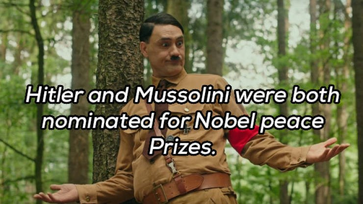 facts history wtf crazy | pic of taika waititi as hitler in the movie jojo rabbit and caption that says Hitler and Mussolini were both nominated Nobel peace Prizes
