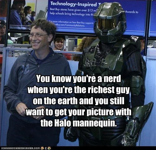 You know you're a nerd when you're the richest guy on the earth and you still want to get your picture with the Halo mannequin.