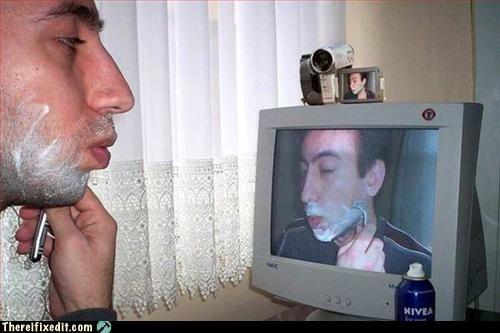 computer,mirror,shaving,web cam