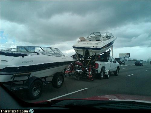 2 boats, a motorcycle, one truck