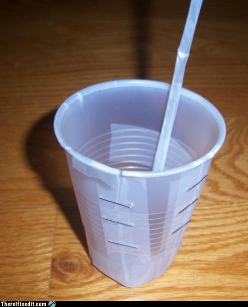 overly attached,plastic cup,staple,straw