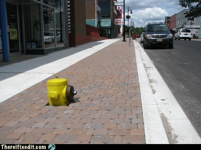 brick,fire hydrant,Professional At Work,sidewalk,tax dollars at work,wrong height