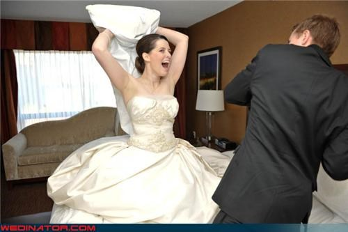 adorable couple,aww,bride,bride and groom pillow fight,bride and groom play fight,fashion is my passion,funny wedding photos,groom,love hurts,pillow fight,surprise,technical difficulties,were-in-love