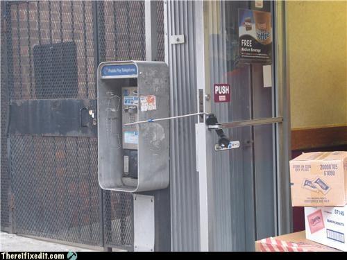 door stop,phone,poll,telephone booth