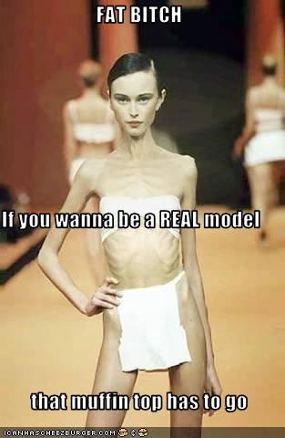 FAT BITCH If you wanna be a REAL model  that muffin top has to go